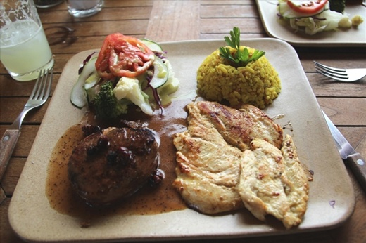 Steak and chicken with rice, salad and the local specialty - ANT sauce