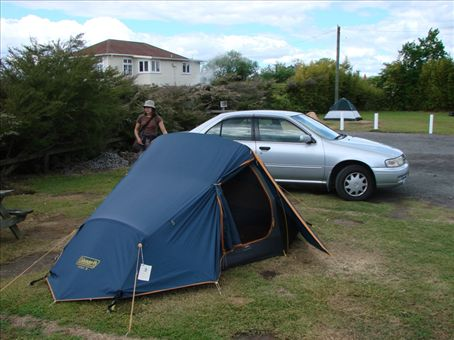 Tent on thermal ground (you can see the steam in the background), Rotorua