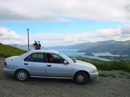 Beck taking a breather from driving a ridiculously windy road across Banks Peninsula