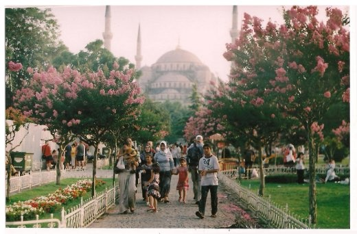 It's a quiet afternoon, the ''man of the family'' take his girls on a walk after praying in Sultanahmet or Blue Mosque, named because of the blue tiles that decorate the walls on the interior.
