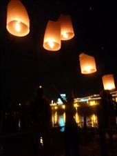 Watching the lanterns (hot air balloons made of rice paper) go up over the river.: by bettedarling, Views[504]