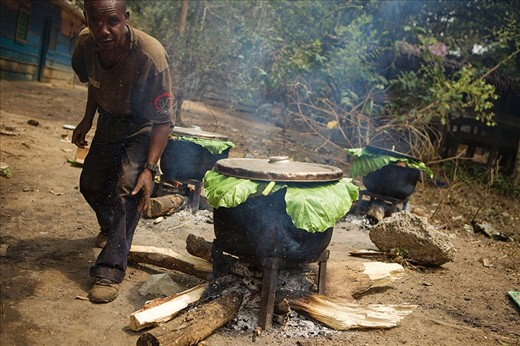 With more than 250 mouths to feed at the sanctuary, food preparation is a vital and constant task. Here Romaine, one of the gorilla keepers, prepares a favourite - sweet potatoes - for the animals.