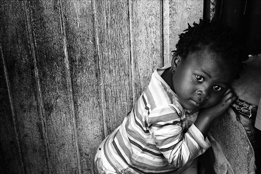 Whilst walking the streets of Soweto, people were welcoming us into their homes even though they did not know us, it was really amazing. We were invited into a shack by a mother, her children were so shy, but I was lucky to snap this pic of her daughter.