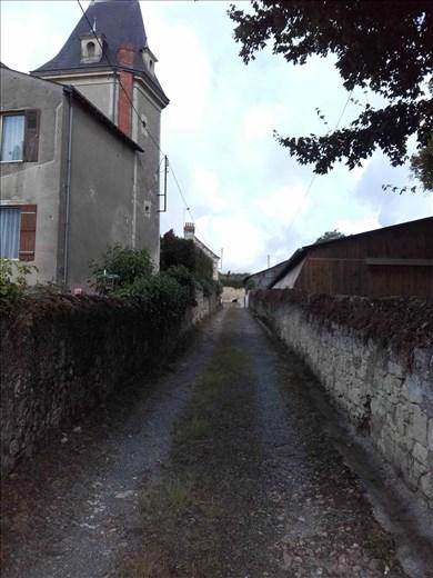 Coutures -- lane next to house
