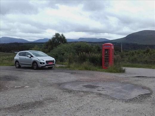 Northwest rural Scotland -- abandoned metal phone booth.01