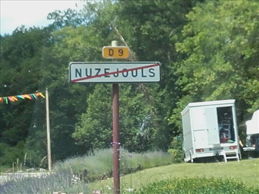 What does the line through this village sign mean?
