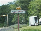 What does the line through this village sign mean?: by billh, Views[215]
