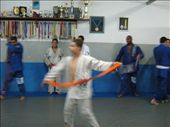 I took this as the boy was dancing and spinning with his belt.  I like the orange stripe his belt makes.: by bjjgirl, Views[451]