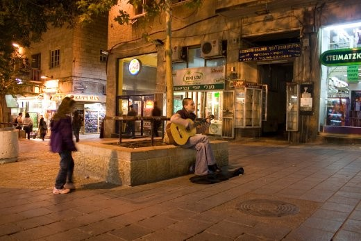 A busker in the middle of a busy street with cafes and stores, at about 0030 hours. As soon as we turned the quiet, almost desolate corner in the previous picture, we were transported into this bright and boisterous world.