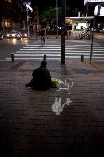 Tel Aviv is a city of contrasts. If you care to look, tucked away behind the swanky high-rises are older, crumbling structures. Sights like this of a homeless person begging on a street corner, were not uncommon.