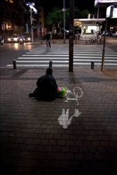 Tel Aviv is a city of contrasts. If you care to look, tucked away behind the swanky high-rises are older, crumbling structures. Sights like this of a homeless person begging on a street corner, were not uncommon.: by bobinjames, Views[175]