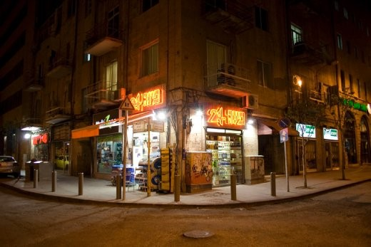 A 24-hour corner store on a Jerusalem street, at about 0030 hours. Standing here, we didn't see the hustle-bustle we were asked to expect. Until we turned the corner, that is.