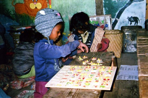 Dipia (Grade 2) is wearing the teachers hat for the day (the beanie is made to look like a mouse and the kids think it is brilliant to get to wear the hat for a day) - that means she gets to help out in class...... here she is having her first go at the new ABC board.