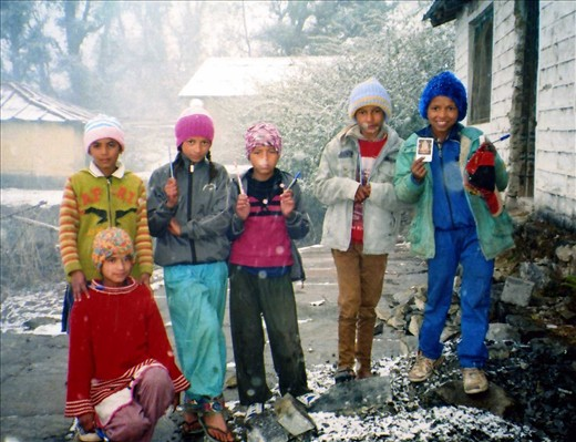 Some Class 6 kids with their new beanies (pens & pencils) in the first snow. January 2014.