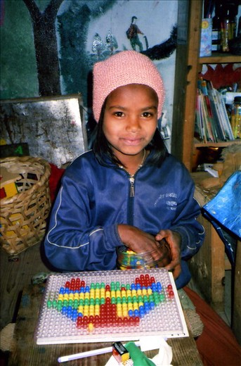 Leela (Class 5) using the peg board during Winter school 2013/14.