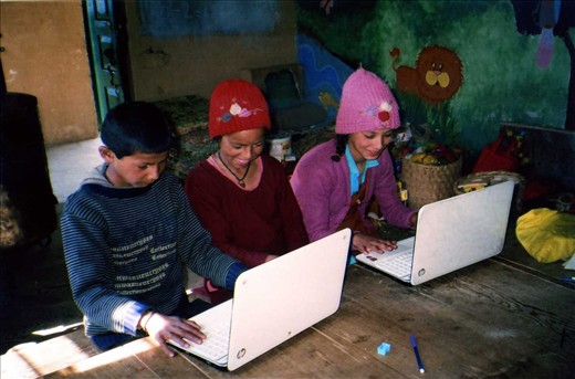 The library pupils couldn't believe that two computers were going to arrive! The excitement was palpable... to be able to touch, feel and use a laptop was the best thing out! Here is a shot of a trio of Class six children on one of their first computer lessons.