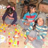 Bublee (Class one) giving me a brilliant smile! The kids are playing with a bucket of wooden blocks and manage to come up with the best building creations you can imagine.: by bonnie, Views[130]