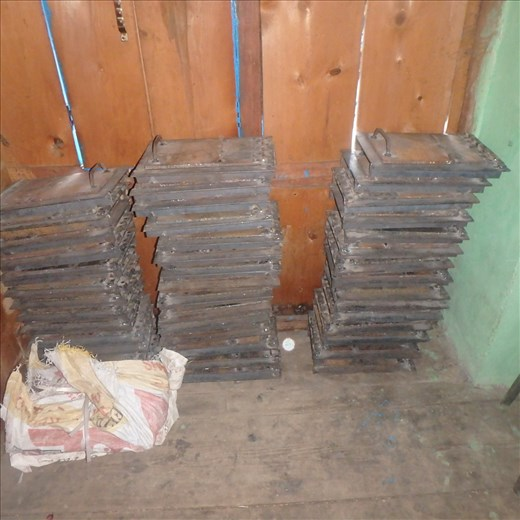 A sample of metal doors used for the chulhas. Made from heavy duty 5mm steel at a workshop in Bageshwar they will be able to withstand years of heat. Two doors are allocated for each stove - one for wood and the other for 'finishing off' rotis.