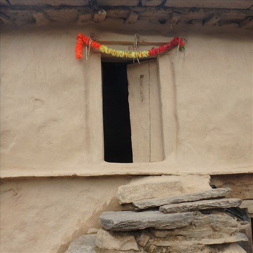 The doorway to a traditional Kumaoni house in rural India, Jatoli (2400m). Some buildings are one hundred years old and the small windows and doorways reflect an age where 'small was good' for heat retention in a cold climate.