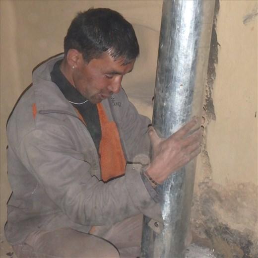 Digember positioning a flue.