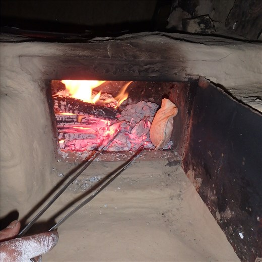 The roti (unleavened bread - the nightly staple) is cooked on the stove top on a 'toy' (metal pan) then finished of on a bed of coals. This is why a two door chulha system was applicable to the local environment/cooking.