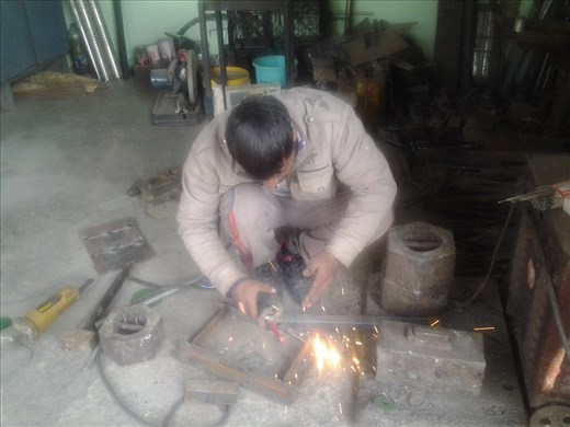 Sharaz working on metal doors for the chulhas
