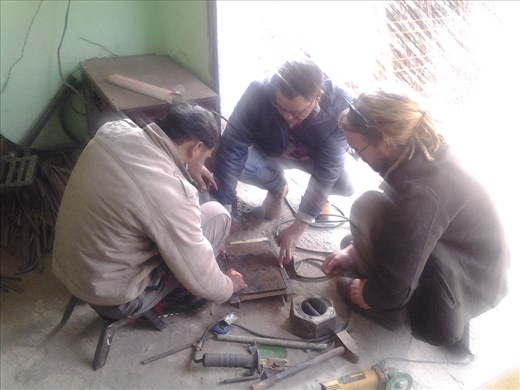 Sharaz, Sharad & Scott discussing the project at the workshop