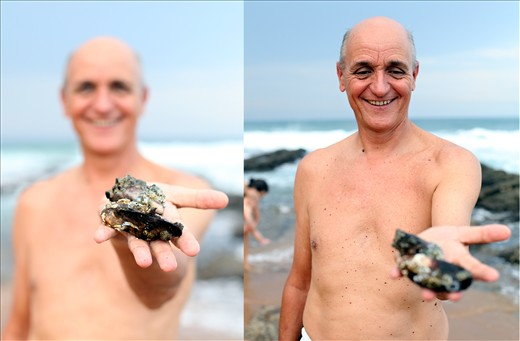 Dad picking mussels at Umhloti beach