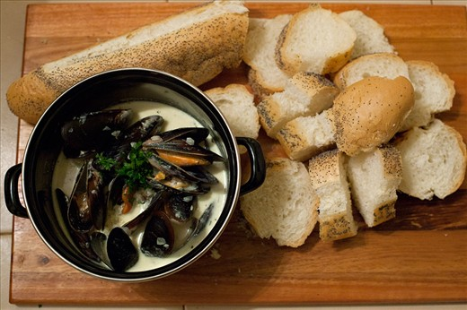Simply yum! Pot of mussel soup with fresh crusty bread