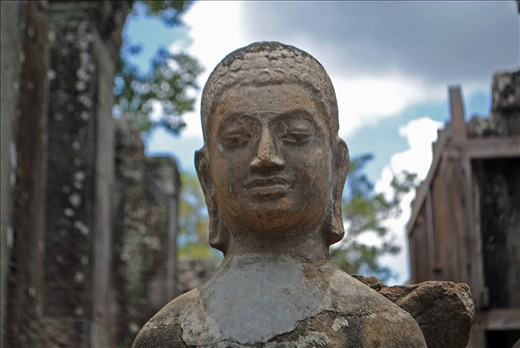 A weathered Buddha statue at Angkor Thom, near Siem Reap in Cambodia. Photo by: Matt Bossons, May 2012.