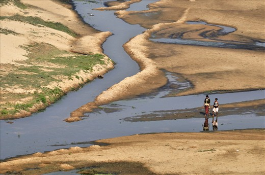 Shallow river bed offers even merriment for tribal children during morning