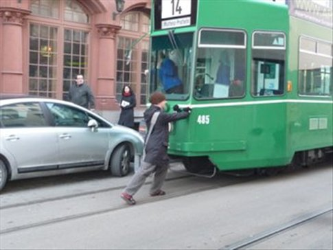 Brad stopping a tram with all his strength.