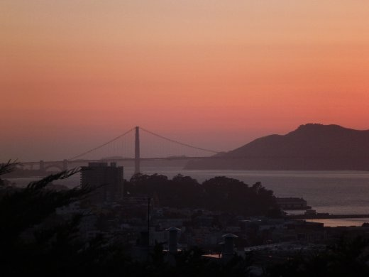 View of Golden Gate bridge sunset from Coit tower