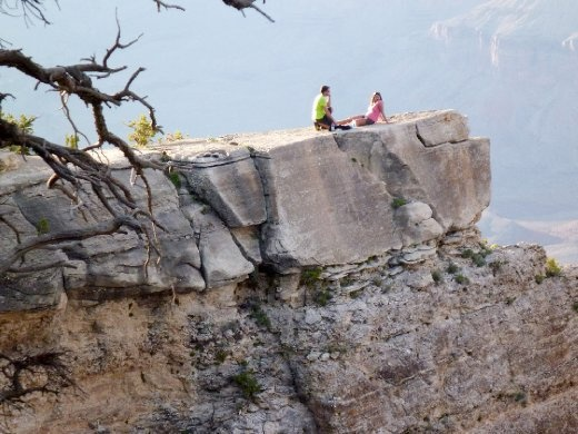 Couple, out on an overhang