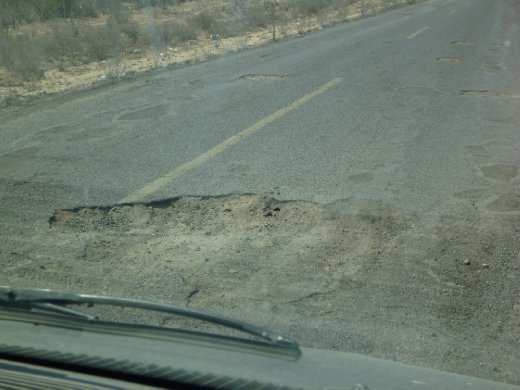 This pothole is quite mild but they are everywhere. Some look like a meteor had just hit!