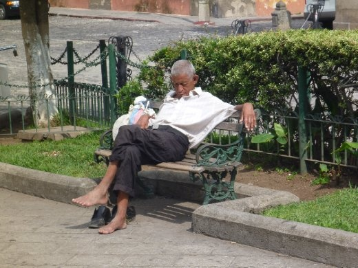 older gentleman having a nap in the Parque Central