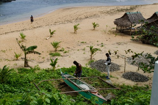 Fishermen prepare their net and their small boat before fishing. Fishing is the primary source of income in the island.