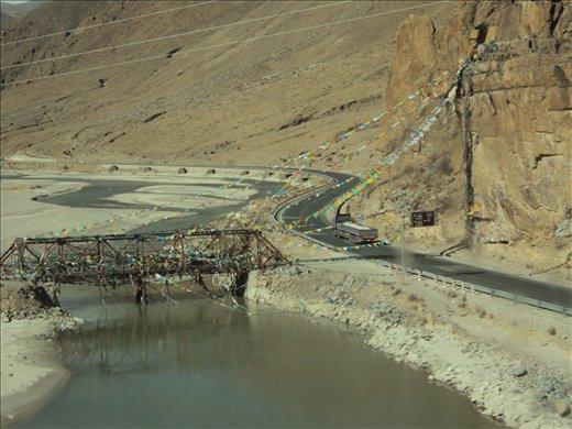 Tibetan prayer flags, roads and more ice