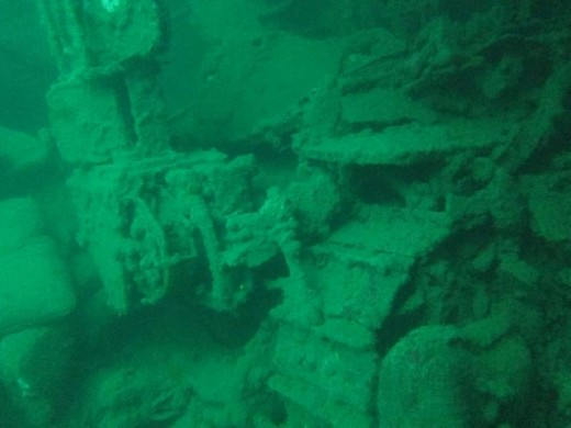 In the second hold back from the bow of the Kogyo Maru is a small bulldozer, a large cement mixer and hundreds of bags of cement