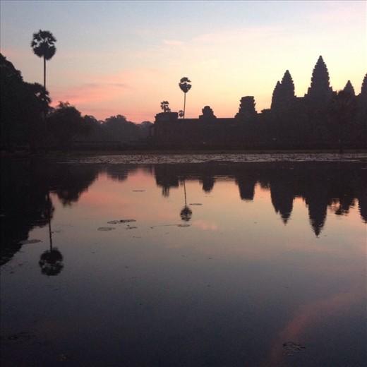 Sunrise behind Angkor Wat