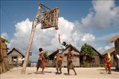 Beach Basketball – Male teenagers play beach basketball at the small fishing village of San Juan on Siargao Island. The pole is made from a coconut tree trunk and the backboard from scattered wood gathered on the island. However, the most important part, according to the players, is making sure that the ground is level and the ball is always inflated.: by camblair, Views[1993]