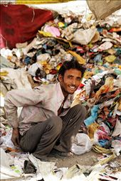 A rag picker, sifts through rubbish to find items that can be resold. He has four children and a wife to provide for. : by camillenelson, Views[157]