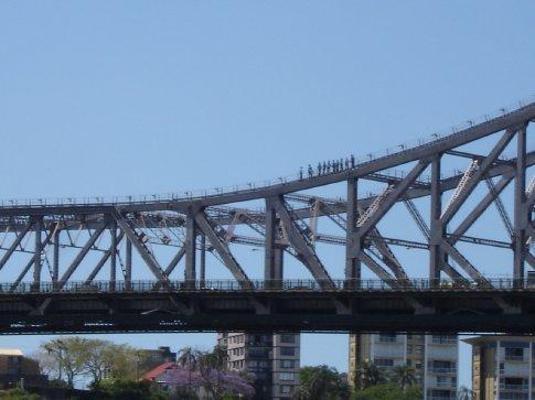 Fools walking across the top of the bridge.