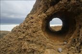 A perfectly round keyhole cut into the coral reef from wind and water.: by canonball, Views[116]
