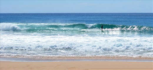 A surfer of the NSW Coast enjoys the ride.