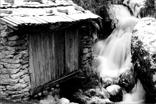On the second day of my Everest trek, I came across this old abandoned water mill, laden with snow. The small water cascade still flows underneath it.