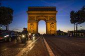 Sun Sets behind the Arc de Triumph and traffics buzzes on the Champs Elysees. : by carlospaillacar, Views[483]