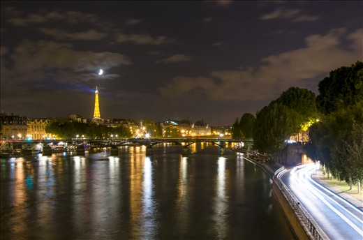 Finally the moon rises behind the Eiffel Tower and night gets going in Paris.