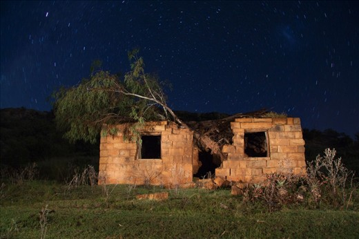This is an old school building at the Masitise Mission Station. It has been abandoned for the last ten years and a Tree climbed on its interior, creating the perfect scene for a long exposure star trail photograph.