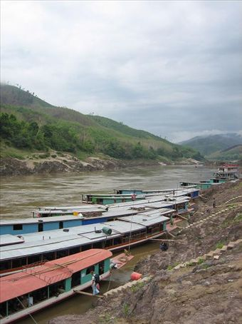 Slow boats lined up on the Mekong, Pak Beng
